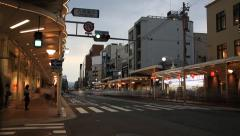Time lapse of traffic and people passing by on Gion street Stock Footage
