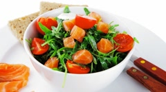 Salad with smoked salmon in white bowl Stock Footage