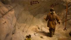 Prehistoric reconstitution of aurignacian artist Stock Footage
