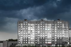 Modern High-Rise Dwelling and Cloudy Dark Sky - stock photo