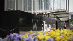 Sears/Willis Tower Pan Down from Flags to Flowers - stock footage