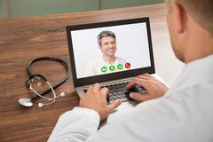 Close-up Of Doctor Talking To Male Patient Through Video Chat On Laptop At De Kuvituskuvat