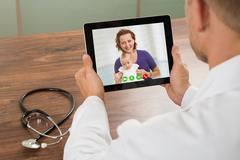 Close-up Of Doctor Talking To Patient Over Laptop Video Chat At Desk Kuvituskuvat