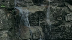 A minor waterfall in the forest - stock footage