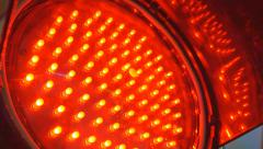 Close up of red LED blink in a traffic light Stock Footage