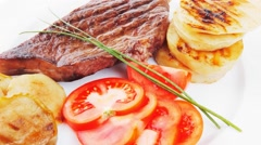 Meat food : roast beef fillet steak served on white Stock Footage
