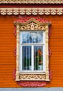 Carved window of wooden house in historical town Kolomna - Russia Stock Photos