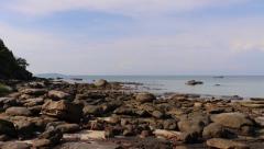 Sokha Beach rocks island bay boats pan L-R Stock Footage
