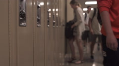 Students walking down hall by lockers (4 of 16) - stock footage