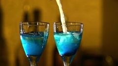 Barman making cocktails at the night club, using two glasses with ice adding - stock footage