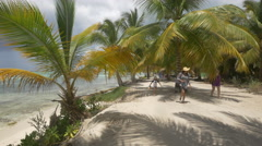 Walking under the palm trees on the beach, Dominican Republic Stock Footage