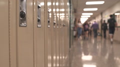 Students walking down hall by lockers (2 of 16) - stock footage