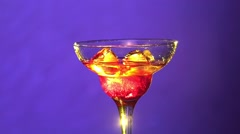 Barman making cocktail in a glass using ice, sweet syrup and two types of Stock Footage