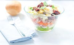 Stock Photo of Seven-layer salad with egg, tuna, dried tomatoes and carrots
