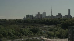 Green city Toronto skyline in background of a large park and highway 2 Stock Footage