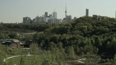 Green city Toronto skyline in background of a large park and highway Stock Footage