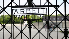 Stock Video Footage of The Arbeit Macht Frei gate at The Dachau Concentration Camp