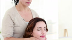 Woman getting reiki therapy Stock Footage