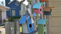 Colorful wooden bird house on the fence, Tilt Down shot - stock footage