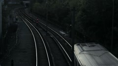 High angle train departing around curve - stock footage