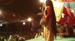 Woman playing traditional Indian music, medium shot, shallow DOF Stock Footage