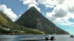St. Lucia Caribbean Sea 118 small Piton with white clouds behind it Stock Footage