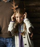 Stock Photo of Girl using leaves as antlers