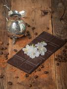 Milk chocolate with white flowers - stock photo