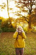 Girl holding branches like antlers Stock Photos