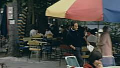 Titisee, West Germany 1967: people having a drink in an outdoor bar Stock Footage
