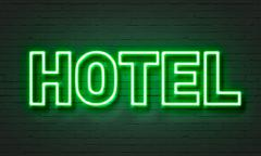 Hotel neon sign - stock illustration