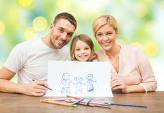 happy family with drawing pencils and picture - stock photo