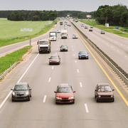 Busy Highway During The Day With Number Plates And Car Logos Rem - stock photo