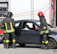 Stock Photo of firefighters in action during the car accident