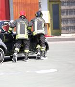 firemen in action during the car accident - stock photo