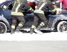 car full of foam after switching off of the fire - stock photo
