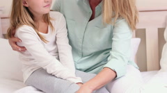 Mother and daughter talking on bed Stock Footage