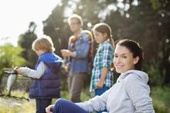 Family fishing together in tall grass Stock Photos