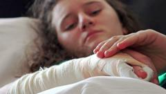 4k Girl pain from broken hand and cast on it lying in hospital bed. UHD stock Stock Footage