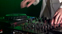 Dj hands on stylish equipment deck, dancing and playing, close up, green Stock Footage