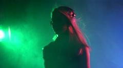 Sexy blonde dj girl playing and listening to music, smoke, silhouette Stock Footage