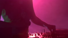 Sexy blonde dj girl playing and listening to music, smoke, silhouette, pink - stock footage