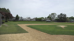 An empty public baseball diamond Stock Footage