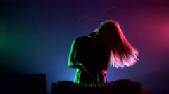 Attractive, smiling dj girl in sexy clothes, flipping hair, hands up, enjoy it - stock footage