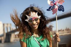 Woman in novelty sunglasses with pinwheel Stock Photos