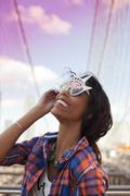 Woman wearing novelty sunglasses outdoors Stock Photos