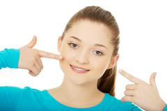 Teenage pointing at toothy smile. Stock Photos