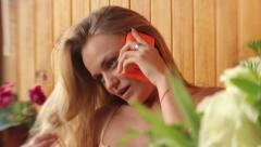A girl in erotic lingerie is talking on the phone. Sexy girl Stock Footage