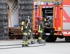 Firefighters with breathing apparatus Stock Photos