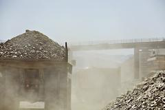 Truck carting rubble in quarry - stock photo